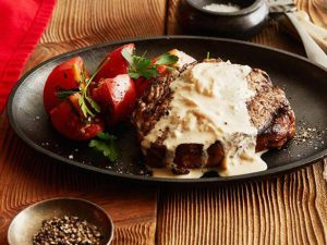 Rib Eye Steak With Onion And Blue Cheese Sauce
