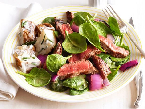 Sirloin Steak And Grilled Onions With Spinach And Potatoes In Sour Cream