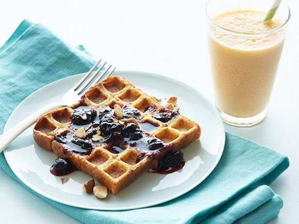 French Toast In A Waffle Iron With Blueberry Sauce And Carrot Ginger Smoothie