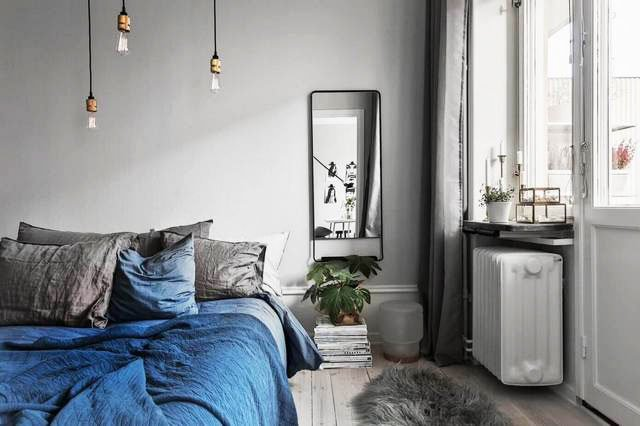 Gray bedroom in Scandinavian style practicality and asceticism