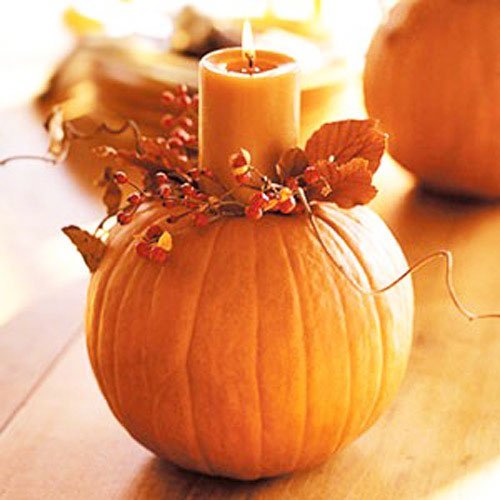 A variety of forms of decorative pumpkins serve as a simple decoration of the table.