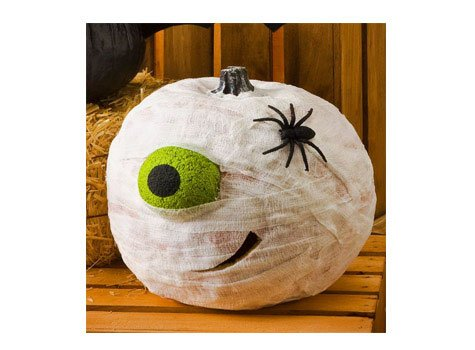 Interesting expressive details for this image of pumpkin-mummy can be bright tennis balls (instead of eyes) and black spiders!