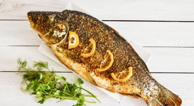 Carp Baked In The Oven Entirely In Foil -Traditional American Thanksgiving Dinner