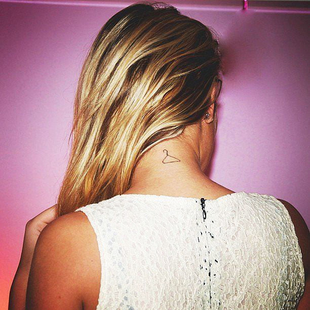Examples of beautiful little tattoos for girls around the neck - Small Delicate Female Tattoos