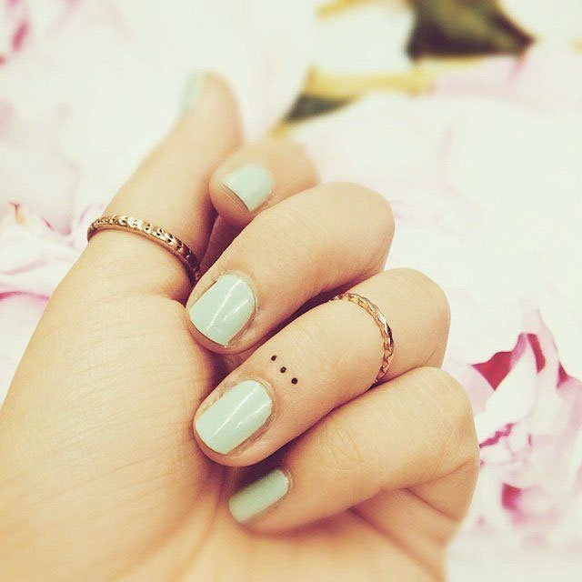 Examples of beautiful little tattoos for girls on their fingers - 37 Small Delicate Female Tattoos Ideas
